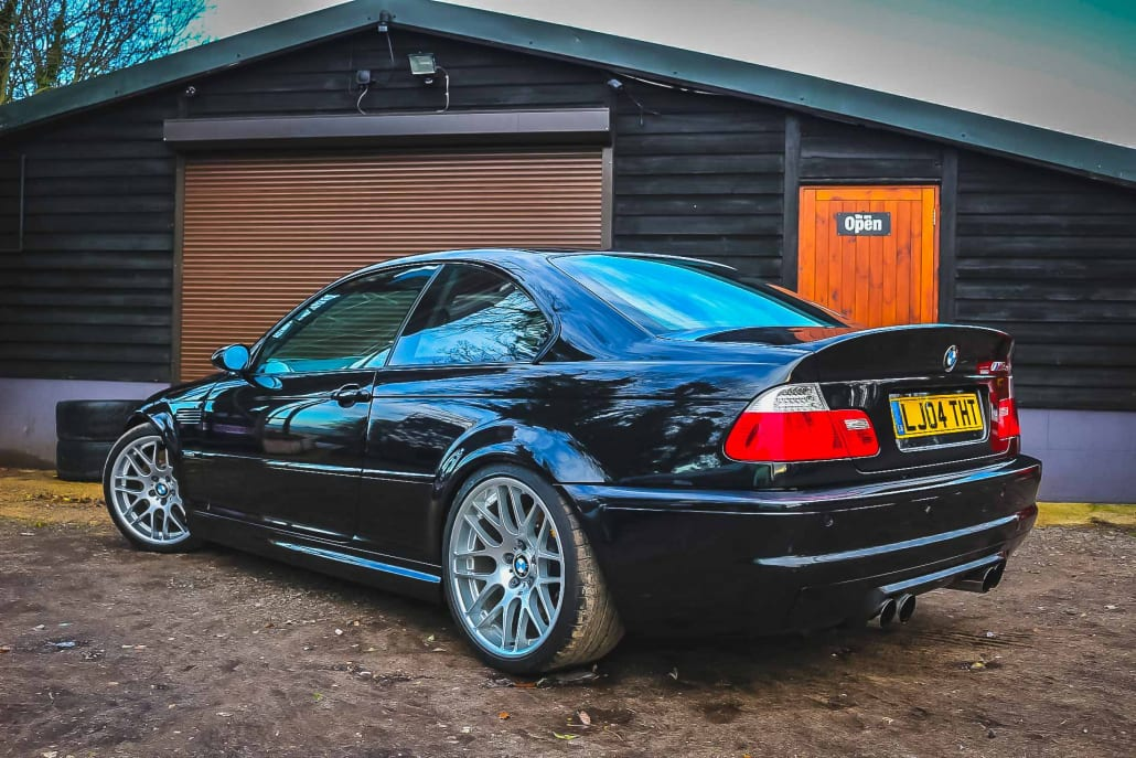 Rear Three Quarter Of Clean, Modified Sapphire Black BMW M3 CSL